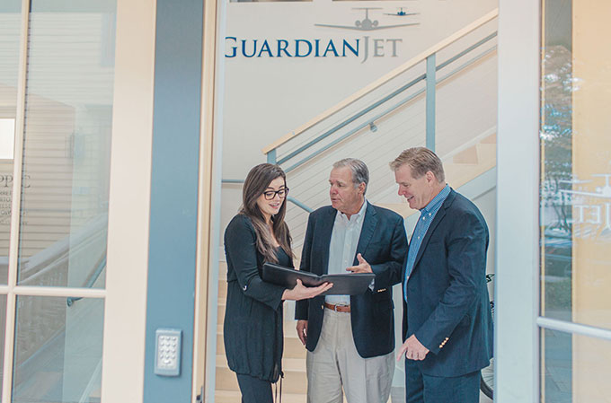 Guardian Jet's Managing Partners Don and Mike Dwyer discuss aircraft sales with market researcher Joan Dywer